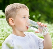 boy_drinking_glass_of_water-180x166-opt