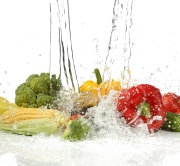 Vegetables with  splashing water on white background
